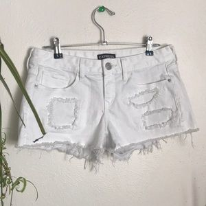 Express low rise white denim distressed shortie
